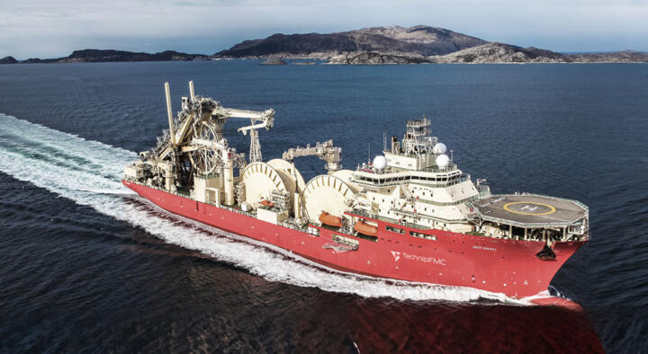 """<strong>Pori (FIN) </strong> <br/>Each of the two reels of the """"Deep Energy"""" pipelayer has a diameter of 25 meters (82feet) and is able to take up 2,800 tons (3,086short tons) of welded, ready-to-lay pipe for pipelines. With a 200-millimeter (7.9-inch) pipe this is enough for a total of more than 90kilometers(56 miles) of pipeline."""